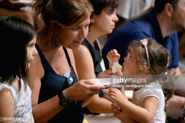 BOLOGNA ITALY AUGUST 8 People attend as jury at the 'Buffalo Mozzarella Challenge' at FICO AgriFood Park on August 8 2018 in Bologna Italy