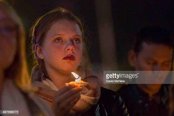 People attend at a memorial and vigil outside City Hall for the victims of the Paris attacks, on November 17, 2015 in Los Angeles, California....