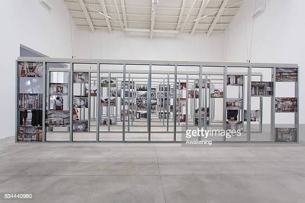 People attend at the Spain Pavillion of the 15th Architecture Venice Biennale on May 26 2016 in Venice Italy The 15th International Architecture...