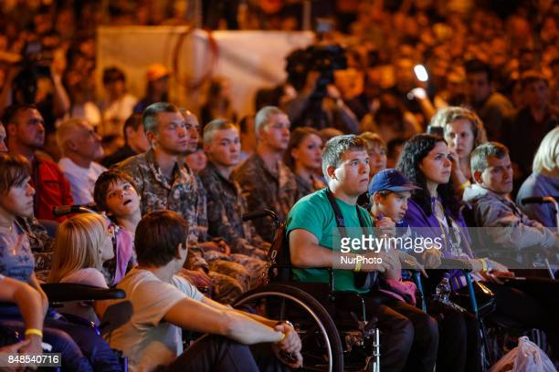 People attend Australian Christian evangelist and motivational speaker Nick Vujicic who was born without limbs performs opair in Kyiv Ukraine in...