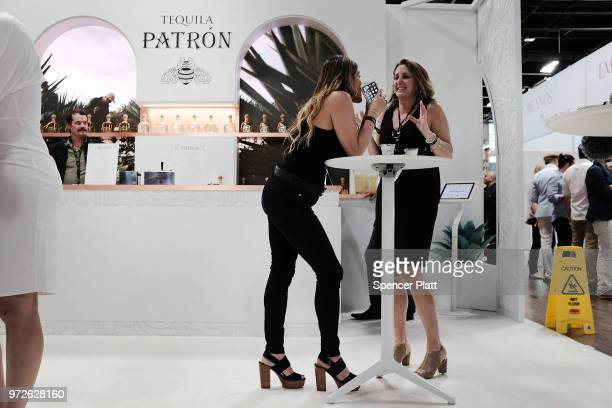 People attend Bar Convent Brooklyn an international bar and beverage trade show at the Brooklyn Expo Center on June 12 2018 in the Brooklyn borough...