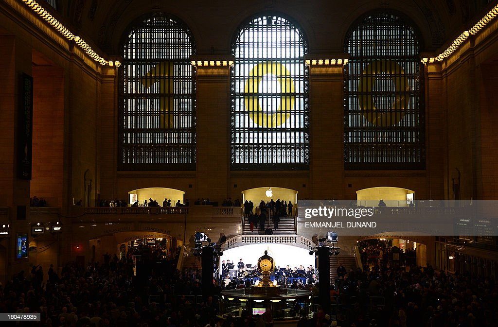 People attend centennial celebrations for Grand Central Terminal in New York, February 1 , 2013 . Grand Central Terminal, the doyenne of US train stations, is celebrating its 100th birthday on February 2, 2013. Opened on February 2, 1913, when trains were a luxurious means of traveling across America, the New York landmark with its Beaux-Arts facade is still one of the US largest transportation hubs and is also New York's second-most-popular tourist attraction, after Times Square. AFP PHOTO/Emmanuel Dunand