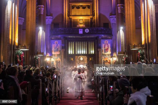 People attend Christmas Eve mass at the Saint Anthony of Padua Church on December 24 2017 in Istanbul Turkey