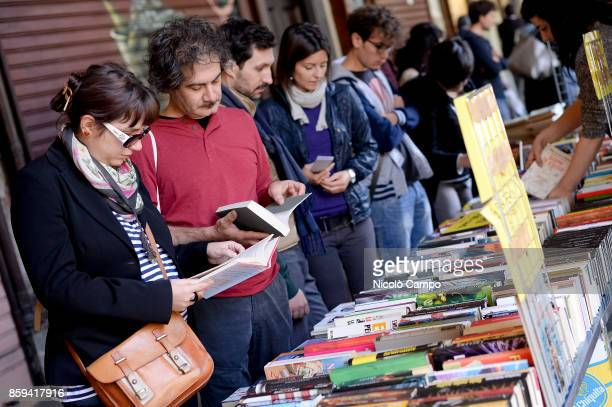 People attend during Portici di Carta Portici di Carta is an annual event where 128 book sellers are placed in the Turin center transforming the...