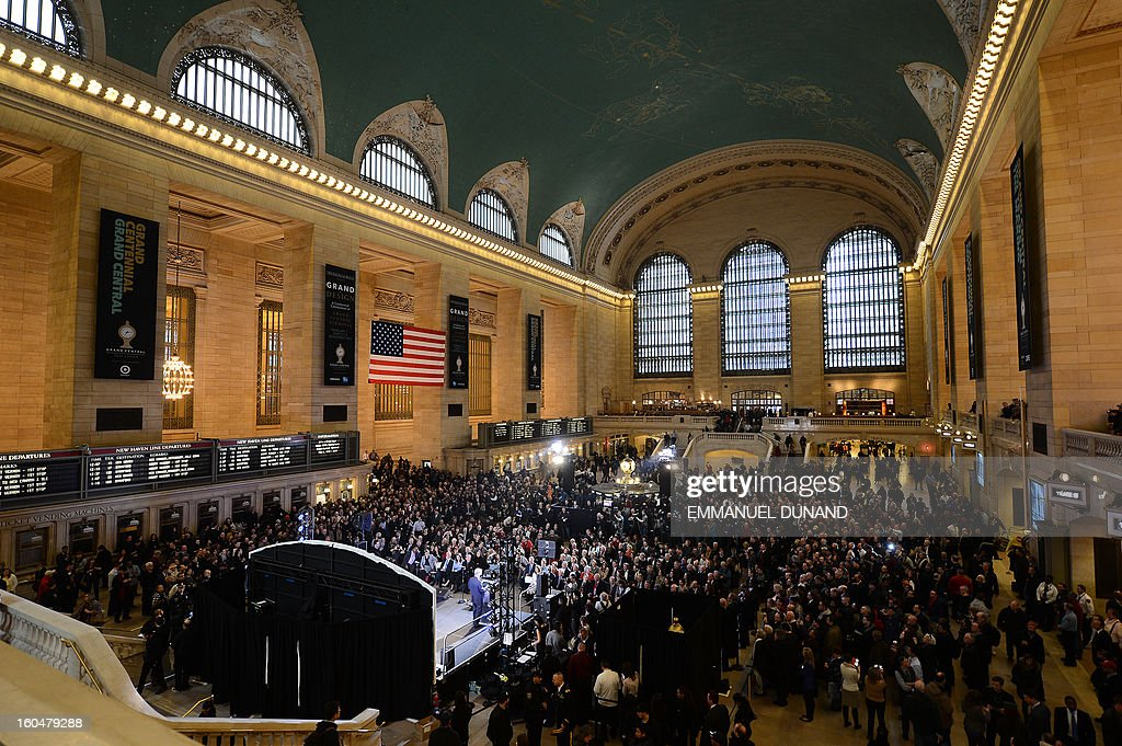 People attend Grand Central Terminal centennial celebrations in New York, February 1 , 2013 . Grand Central Terminal, the doyenne of US train stations, is celebrating its 100th birthday on February 2, 2013. Opened on February 2, 1913, when trains were a luxurious means of traveling across America, the New York landmark with its Beaux-Arts facade is still one of the US largest transportation hubs and is also New York's second-most-popular tourist attraction, after Times Square. AFP PHOTO/Emmanuel Dunand