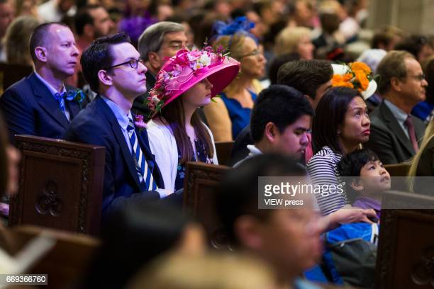 People attend mass at St Patrick Cathedral during the Annual Easter parade on April 16 2017 in New York City The Easter Parade and Easter Bonnet...