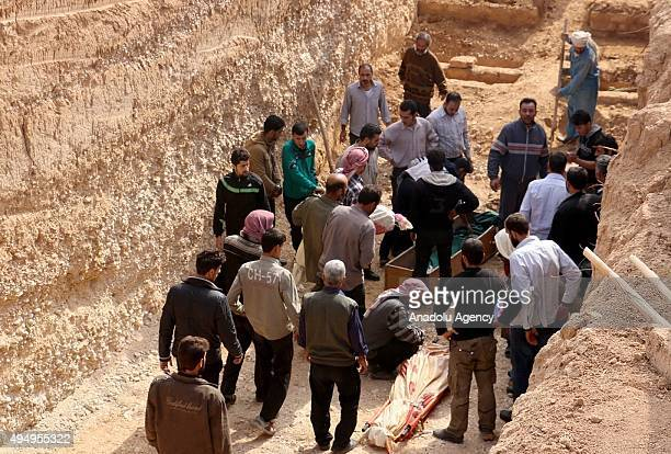 People attend mass burial ceremony for the victims killed by Assad Regime Forces' airstrike over residential areas in Douma east of Damascus Syria on...