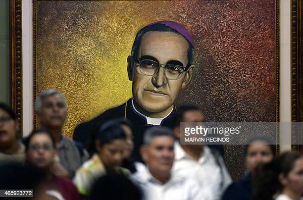 People attend mass in the tomb of Archbishop Oscar Romero during the visit by Vatican official Italian Archbishop Vincenzo Paglia in San Salvador on...
