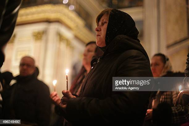 People attend memorial service in the memory of Russian airplane crash victims in Egypt at Saint Isaac's Cathedral in St Petersburg Russia on...