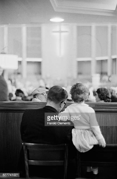 People attend morning service at a 'chatter & cough' box at City Temple, Holborn, London, 24th August 1958.