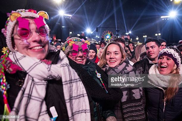 People attend New Year celebrations at the Brandenburg Gate during on January 1 2016 in Berlin Germany