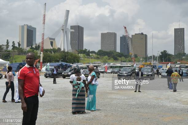 People attend on March 22 2019 the official launch of the construction work of the 5th CocodyPlateau bridge in the Cocody Bay in Abidjan Ivorian...