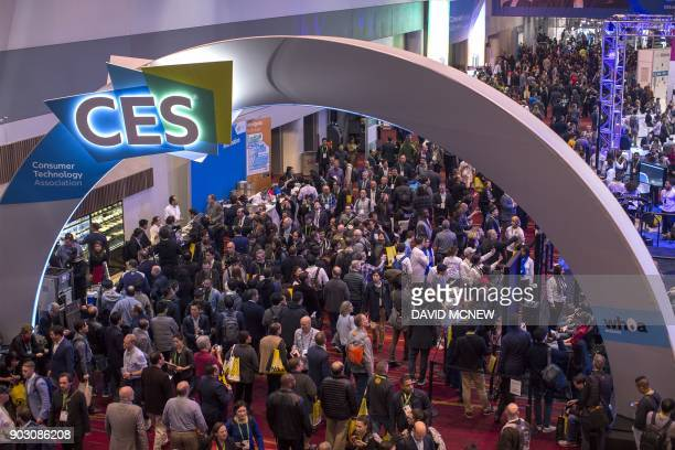 People attend opening day of CES in Las Vegas Nevada January 9 2018 / AFP PHOTO / DAVID MCNEW