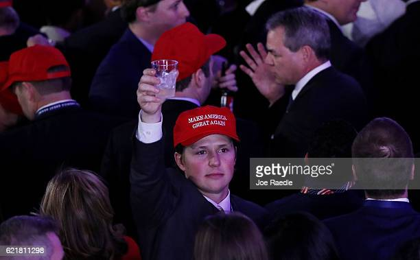 People attend Republican presidential nominee Donald Trump's election night event at the New York Hilton Midtown on November 8, 2016 in New York...