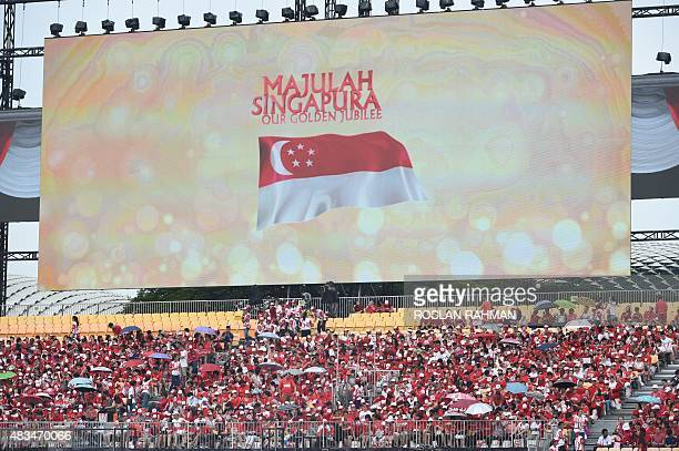 People attend Singapore's 50th National day anniversary celebration at the Padang in Singapore on August 9 2015 Singapore celebrated 50 years of...