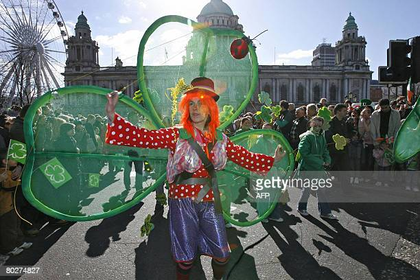 People attend St Patricks day celebrations in Belfast, Northern Ireland, on March 17, 2008. Hundreds of thousands of revellers throughout Ireland...