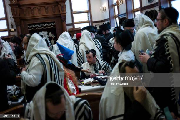 People attend Synagogue during the annual Jewish holiday of Purim on March 12 2017 in London England Purim is celebrated by Jewish communities around...