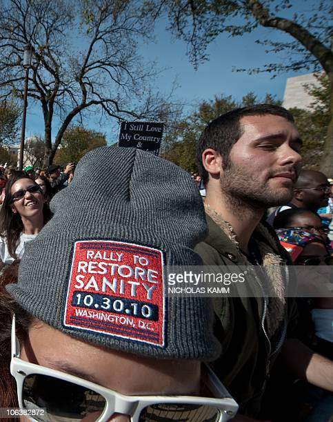 People attend television satirists Jon Stewart and Stephen Colbert's Rally to Restore Sanity and/or Fear on the National Mall in Washington on...