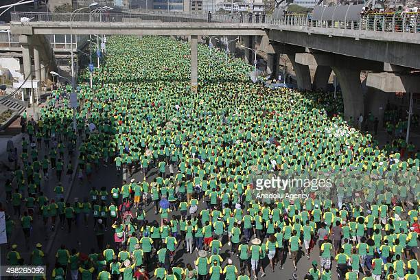 People attend the 15th Ethiopia Marathon based on the slogan 'Running for the Planet' in Addis Ababa Ethiopia on November 22 2015 Approximately 40000...