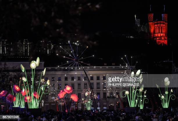 People attend the 19th edition of the Festival of Lights on December 7 2017 in Lyon The Festival of Lights marks each year since December 8 on the...