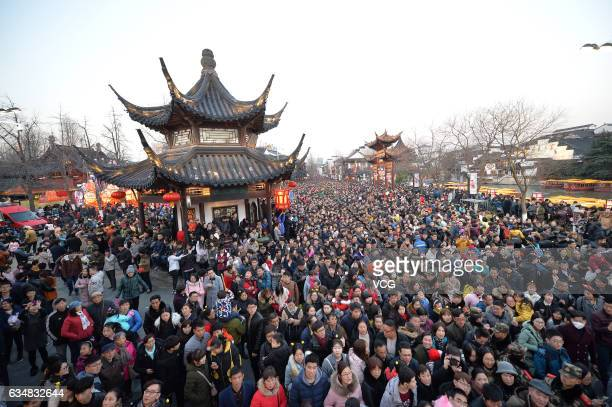 People attend the 31st Qinhuai Lantern Fair at Confucius Temple during the Lantern Festival on February 11 2017 in Nanjing Jiangsu Province of China...