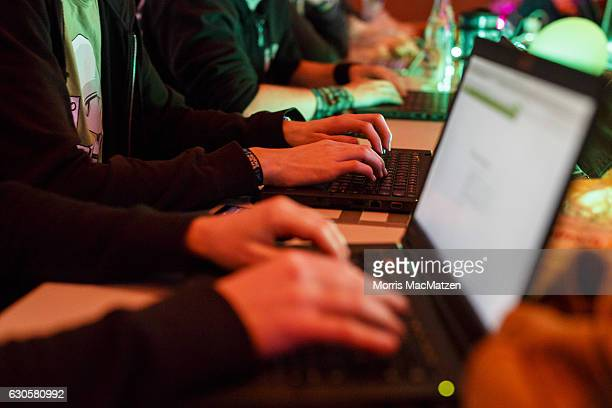 People attend the 33rd Chaos Communication Congress on its opening day on December 27 2016 in Hamburg Germany The annual event is bringing together...