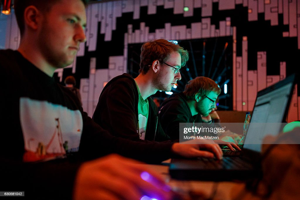 People attend the 33rd Chaos Communication Congress on its opening day on December 27, 2016 in Hamburg, Germany. The annual event is bringing together 12,000 computer hackers and activists who will meet over the next four days to share expertise and discuss topics related to the society and the digital world.