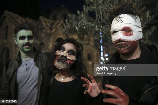 People attend the 5rd Zombie walk with scary costumes in Athens Greece on February 25 2017