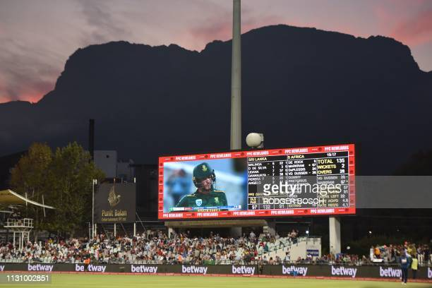 People attend the 5th One Day International cricket match between Sri Lanka and South Africa at Newlands Stadium in Cape Town on March 16 2019 South...