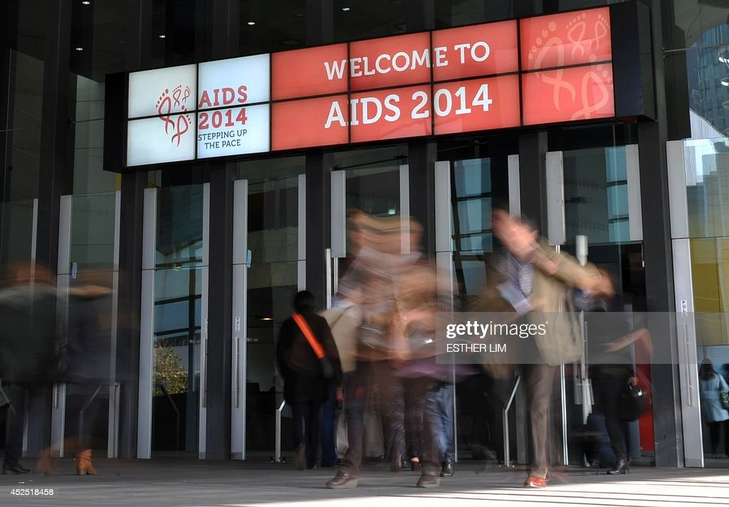 People attend the AIDS Conference 2014 at the Melbourne Convention and Exhibition Centre (MCEC) in Melbourne on July 22, 2014. The elusive quest for an HIV cure received a boost at the world AIDS conference on July 22 as scientists said they had forced the virus out of a hiding place where it had lurked after being suppressed by drugs.