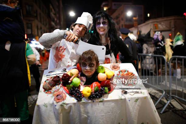 People attend the Annual Halloween parade after a man driving a rental truck struck and killed eight people on a jogging and bike path on October 31...