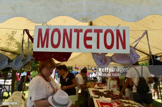 People attend the annual meeting of French towns and villages with oddsounding names on July 7 2018 in Monteton southwestern France