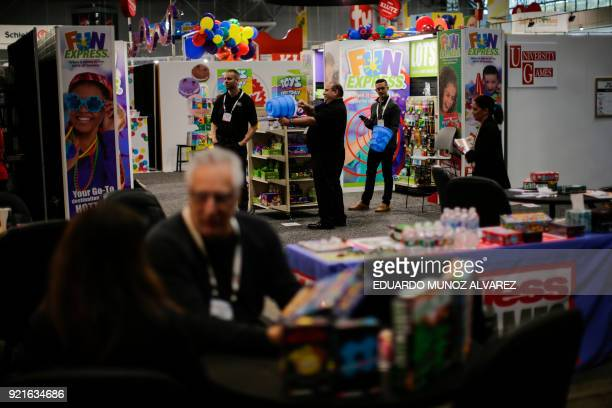 People attend the annual New York Toy Fair at the Jacob K Javits Convention Center on February 20 in New York / AFP PHOTO / EDUARDO MUNOZ ALVAREZ