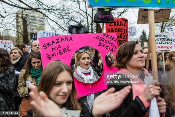TOPSHOT People attend the antigovernment proabortion demonstration in front of parliament on April 9 2016 in Warsaw The banner reads ' Sentenced to...