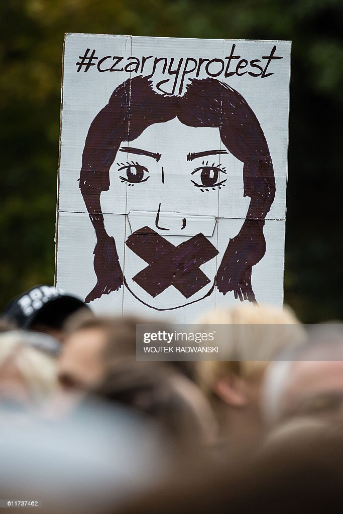 People attend the anti-government, pro-abortion demonstration in front of Polish Pariament in Warsaw, Poland on October 1, 2016. / AFP / WOJTEK