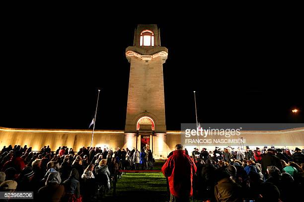 People attend the Anzac day in tribute of Australians and New Zealanders soldiers killed in combat at the Australian Memorial of the World War I...