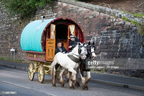 People attend the Appleby Horse Fair, an annual gathering of travellers, in Cumbria.