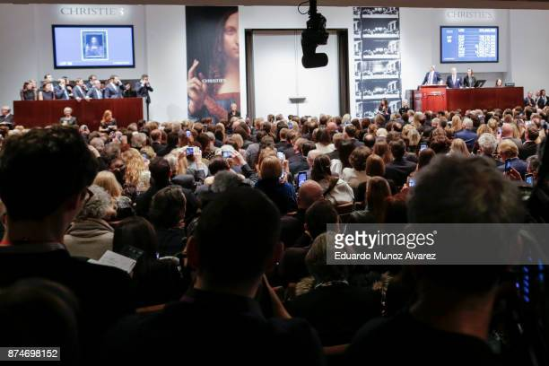People attend the auction of Leonardo da Vinci's Salvator Mundi during the PostWar and Contemporary Art evening sale at Christie's on November 15...