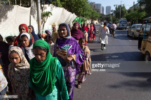 People attend the Aurat March for International Women's Day on March 08, 2021 in Karachi, Pakistan. An end to gender-based violence, sexual...