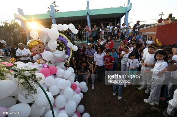 People attend the burial of a sevenyearold girl whose body was found over the weekend with signs of torture at a cemetery in Mexico City on February...