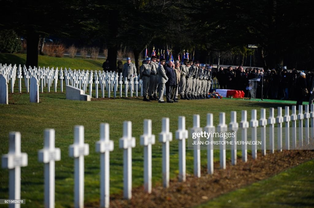 People attend the burial of three French soldiers who died during World War I in the Douaumont ossuary military cemetery in Douaumont, eastern France, on February 21, 2018. The remains were found in May 2015 during construction work at Douaumont memorial, which contains the remains of soldiers who died during the 10-month scorched-earth battle between French and German forces. The body of Sergeant Claude Fournier was identified by DNA samples from his relatives. /