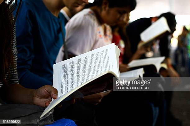 People attend the celebration of the World Book Day in Guadalajara Mexico on April 23 2016 About 600 people for over 12 hours took part in the...
