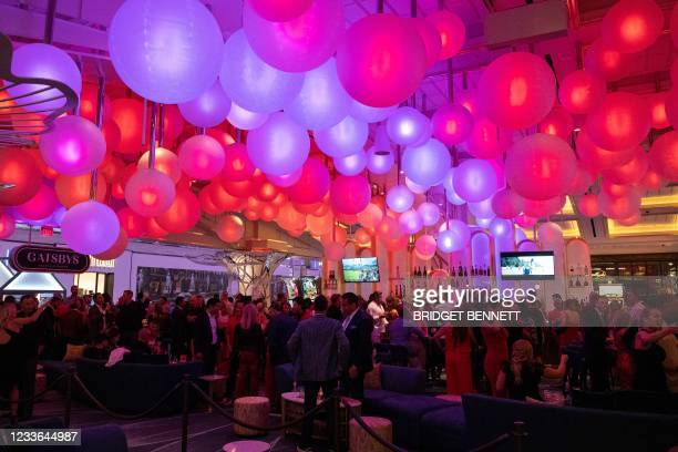 People attend the celebratory grand opening of Resorts World Las Vegas hotel and casino on June 24, 2021 in Las Vegas, Nevada. - A giant new Las...