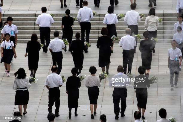 People attend the ceremony marking the 74th anniversary of the atomic bombing of Hiroshima at the Hiroshima Peace Memorial Park on August 6, 2019 in...