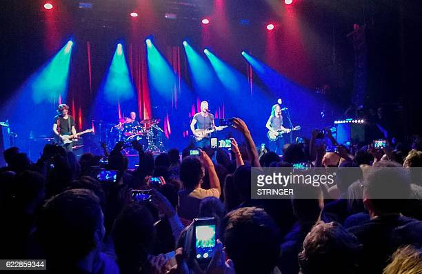 People attend the concert of British musician Sting at the Bataclan concert hall in Paris on November 12 a concert marking the first anniversary of...