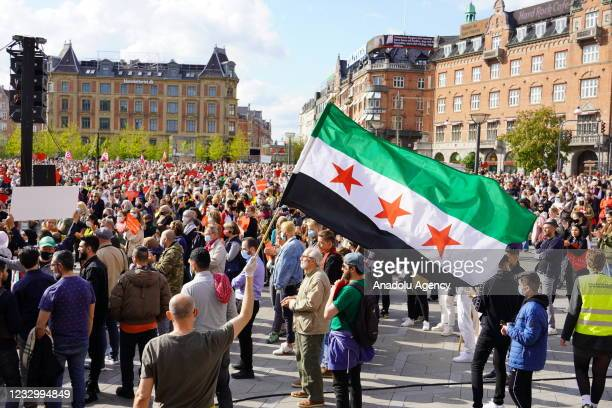 People attend the demonstration to protest against the decision of the deportation of Syrian refugees, in Copenhagen, Denmark on May 19, 2021.