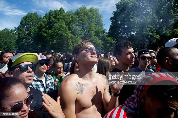People attend the Denver 420 Rally the world's largest celebration of both the legalization of cannabis and cannabis culture May 21 2016 in Denver...