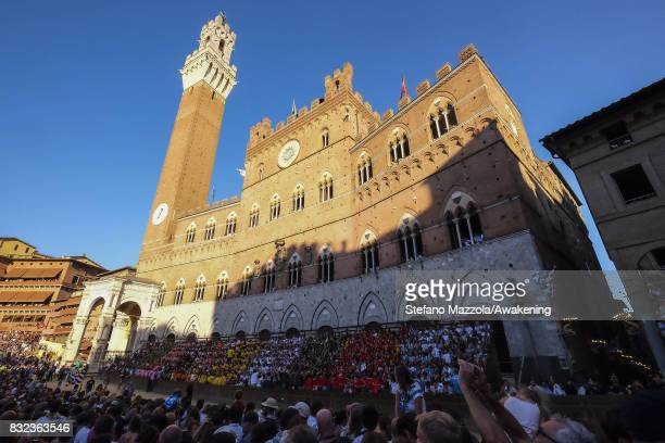 People attend the dry run at Piazza del Campo ahead of tomorrow's Palio on August 15 2017 in Siena Italy The Palio is the most famous event in Siena...