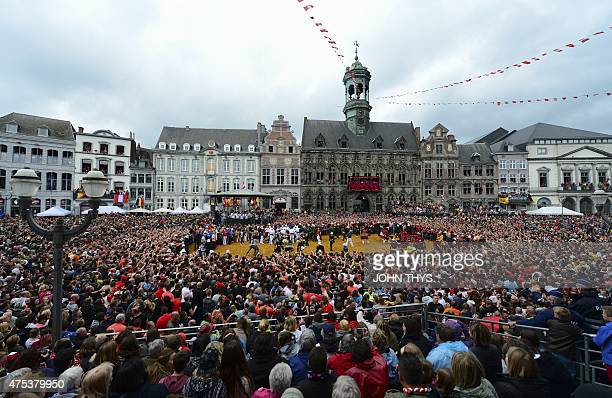 People attend the Ducasse Doudou folkloric festival in Mons on May 31 2015 The Doudou feast compromises two parts a procession with the shrine of...