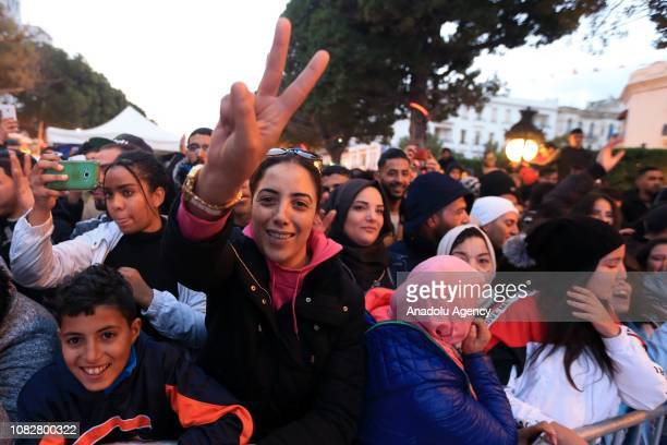 People attend the eighth anniversary of Arab Spring celebrations at Habib Burgiba Street in the capital Tunis on January 14 2019